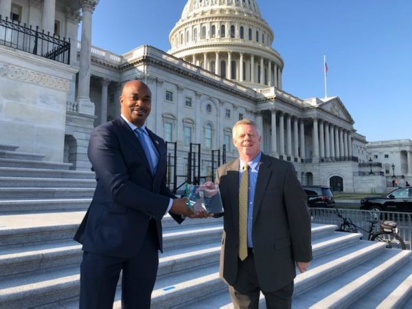 Kwanza Hall accepts term limits plaque